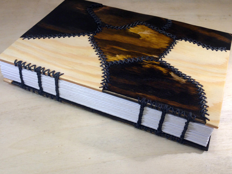 01_wooden_stitched book